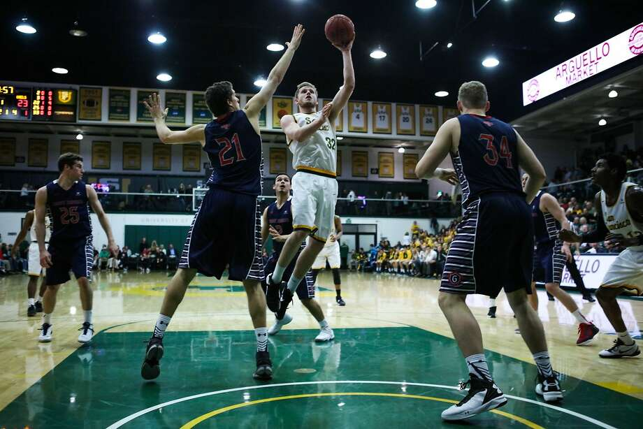 University of San Francisco guard Tim Derksen (32) shoots the ball during a game against St.Mary's at USF, in San Francisco, California, on Saturday, Feb. 27, 2016. Photo: Gabrielle Lurie, SPECIAL To THE CHRONICLE