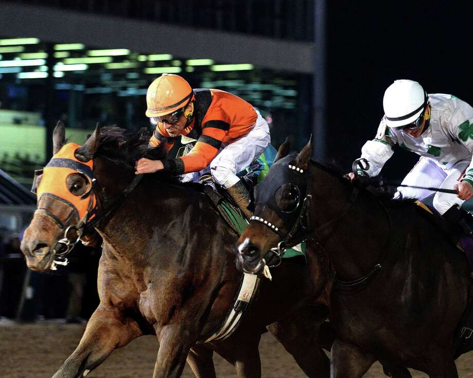 Mobile Bay, with Francisco Torres in the irons, heads to the finish line as the winner of the $100,000 Maxxam Gold Cup at Sam Houston Race Park. / handout