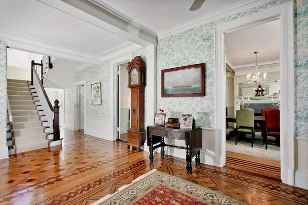 Firwood's foyer has floors made from three kinds of wood: oak; mahogany; and walnut. They were crafted by artisans who worked for Hugh Collender's billiard table factory when Collender built the house. Photo: Contributed Photo / Darien News