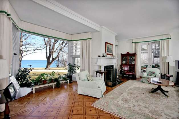The sitting room at Firwood, with a view of the Long Island Sound and an entryway to one of the home's two greenhouses. Photo: Contributed Photo / Darien News