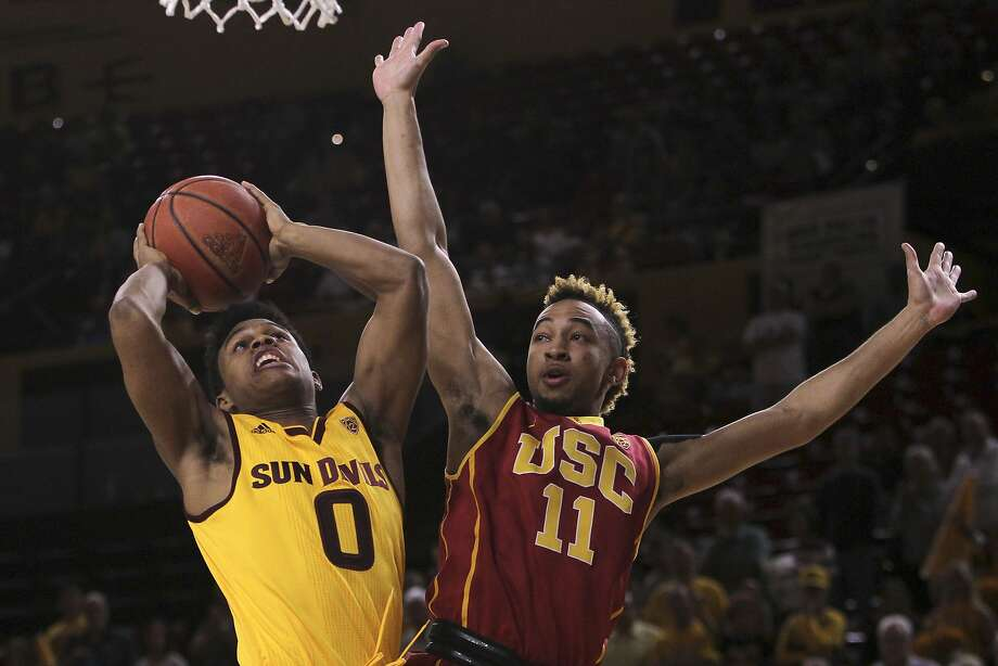 Arizona State guard Tra Holder (0) goes to the basket against Southern California guard Jordan McLaughlin during the first half of an NCAA college basketball game in Tempe, Ariz., Friday, Feb. 12, 2016. (AP Photo/Ricardo Arduengo) Photo: Ricardo Arduengo, Associated Press
