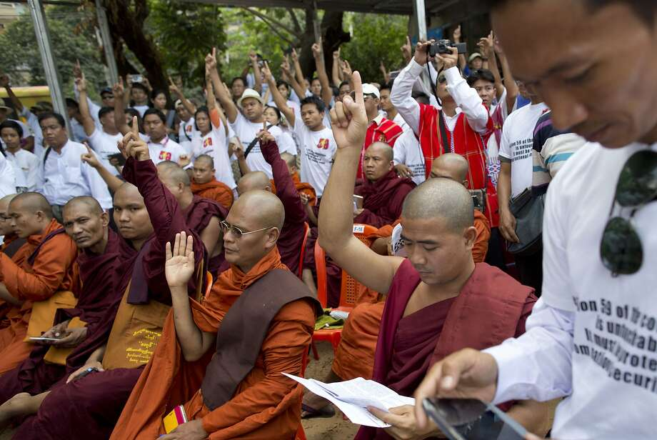 Supporters of nationalists, including Buddhist monks, demonstrate in favor of a constitutional clause barring Aung San Suu Kyi from becoming head of state. Photo: Gemunu Amarasinghe, Associated Press