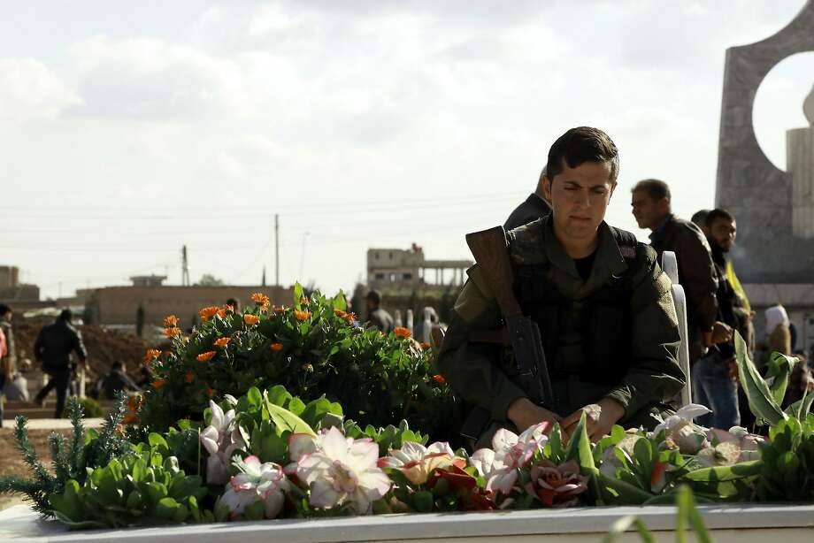 A man mourns at the funeral for a Kurdish fighter killed in an attack on the Syrian city of Tal Abyad. Photo: Delil Souleiman, AFP / Getty Images