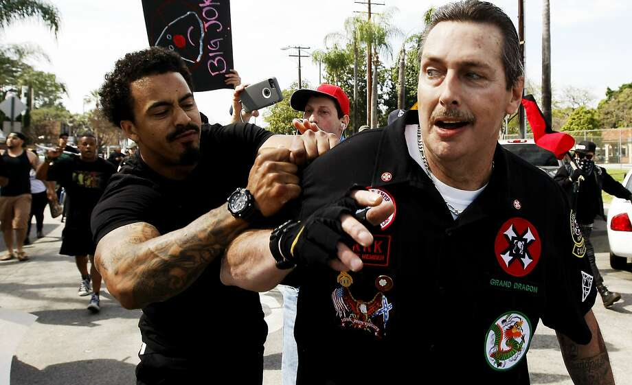 A counterprotester tries to tear the shirt of a Klansman during the clash Saturday in Anaheim. Photo: Luis Sinco, Associated Press