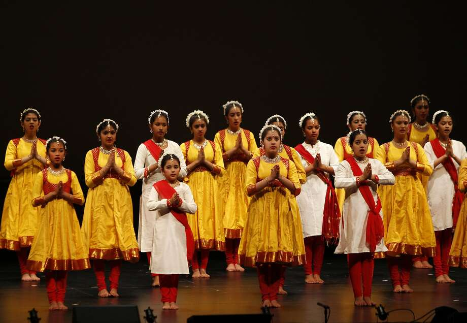 """Students of the Chhandam Youth Dance Company gather on stage before the performance of """"Shiva,"""" put on by the Chitresh Das Dance Company in honor of its founder and artistic leader, Pandit Chitresh Das. Photo: Brittany Murphy, The Chronicle"""