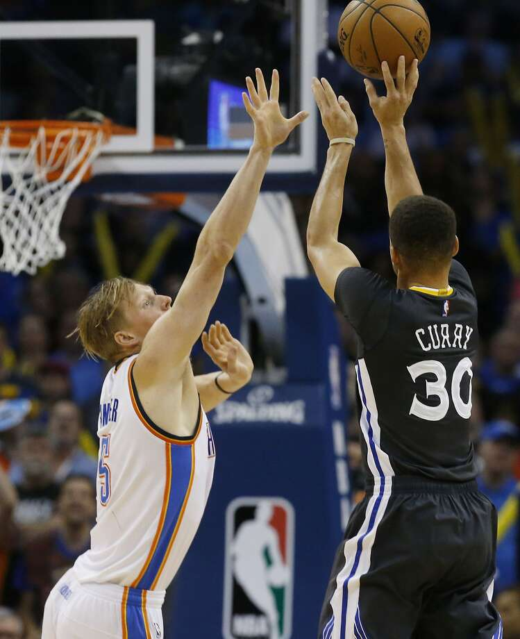 Golden State Warriors guard Stephen Curry (30) shoots over Oklahoma City Thunder forward Kyle Singler during overtime of an NBA basketball game in Oklahoma City, Saturday, Feb. 27, 2016. Golden State won 121-118. Curry had 12 3-pointers in the game. (AP Photo/Sue Ogrocki) Photo: Sue Ogrocki, Associated Press