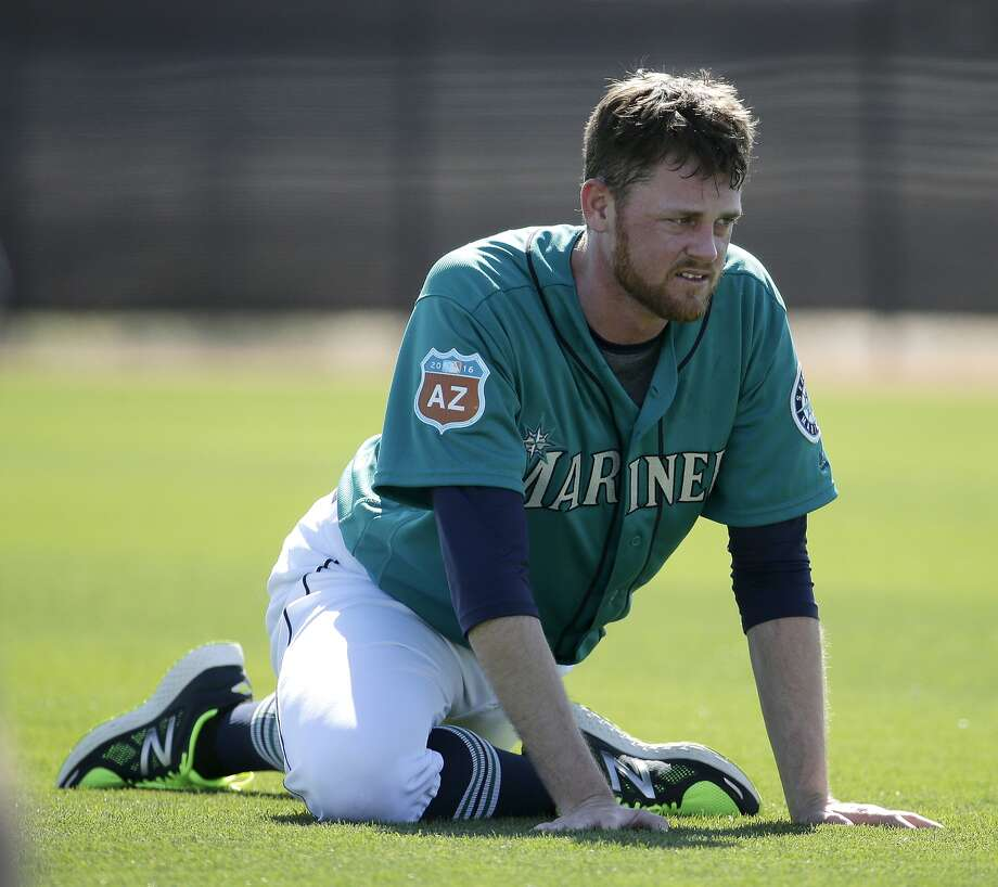 Seattle Mariners' Charlie Furbush stretches during spring training baseball practice Monday, Feb. 22, 2016, in Peoria, Ariz. (AP Photo/Charlie Riedel)