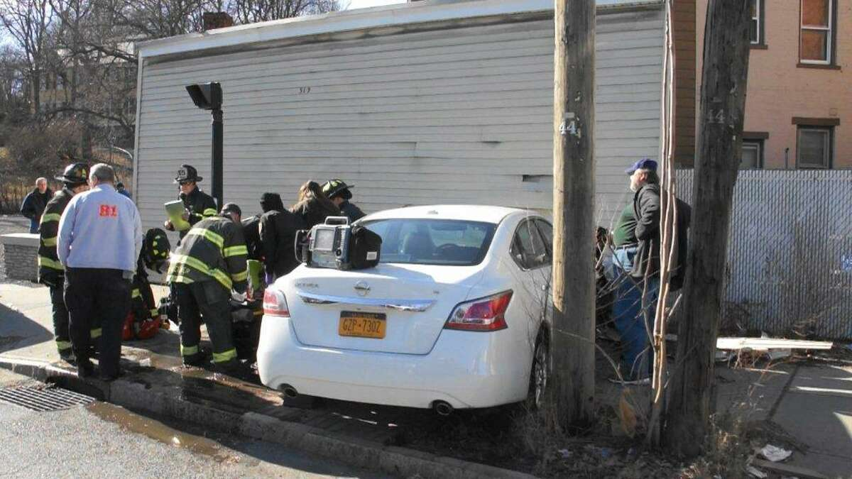 A pedestrian was injured during a chase and crash that ended in Albany Saturday afternoon. (Martin Miller / Special to the Times Union)