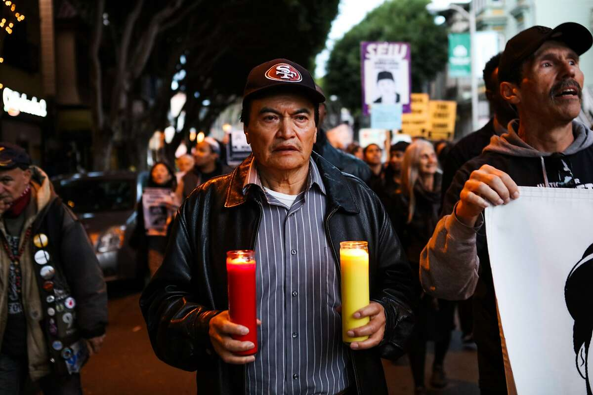 Refugio Nieto, the father of the fatal officer-involved shooting of Alex Nieto, holds candles as he walks in a march for justice on 24th Street, in San Francisco, California, on Friday, February 26, 2016.