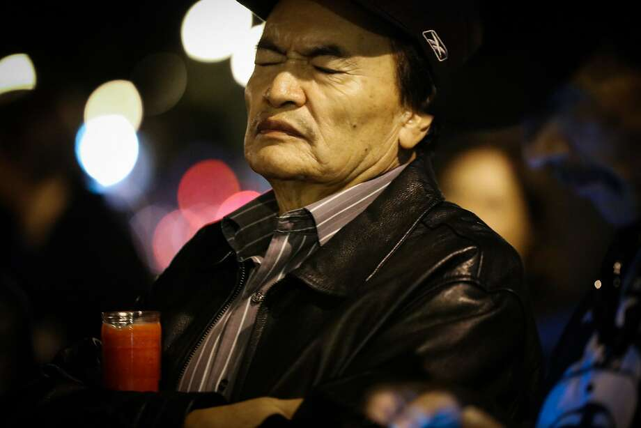 Refugio Nieto, father of slaying victim Alejandro Nieto, listens to poetry read at the protest against San Francisco police shootings. Photo: Gabrielle Lurie, Special To The Chronicle