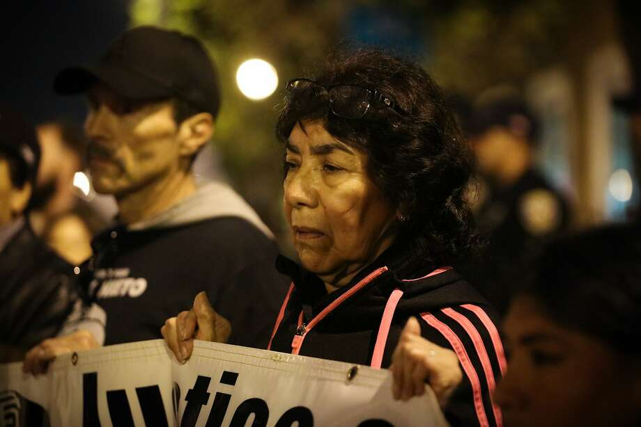 Elvira Nieto (center), mother of slain Alex Nieto, gets emotional as she listens to a graphic poetry reading during a protest against police shootings. Photo: Gabrielle Lurie, Special To The Chronicle