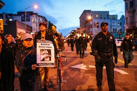Marchers on Valencia Street protest police killings, in a demonstration marking the one-year anniversary of the fatal shooting of Amilcar Perez-Lopez. Photo: Gabrielle Lurie, Special To The Chronicle