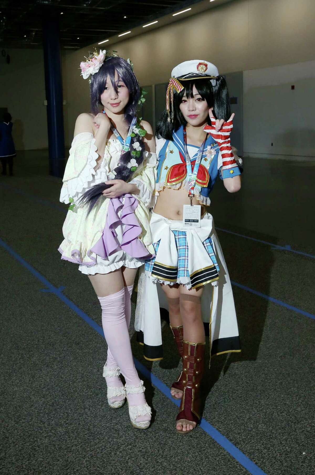 People pose for a photo at the Anime Matsuri convention Sunday, Feb. 28, 2016, in Houston.