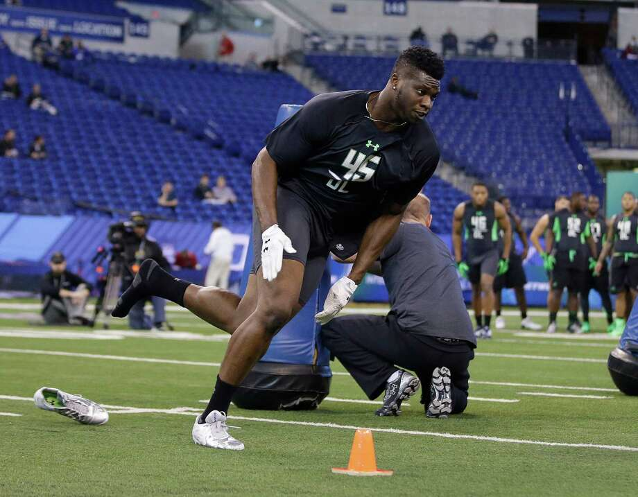 Oklahoma State defensive lineman Emmanuel Ogbah runs a drill at the NFL football scouting combine on Sunday, Feb. 28, 2016, in Indianapolis. (AP Photo/Darron Cummings) Photo: Darron Cummings, Associated Press / AP