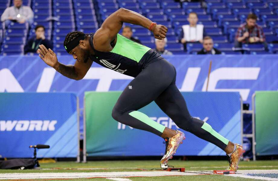 Michigan State defensive lineman Shilique Calhoun runs the 40-yard dash at the NFL football scouting combine in Indianapolis, Sunday, Feb. 28, 2016. (AP Photo/Michael Conroy) Photo: Michael Conroy, Associated Press / AP