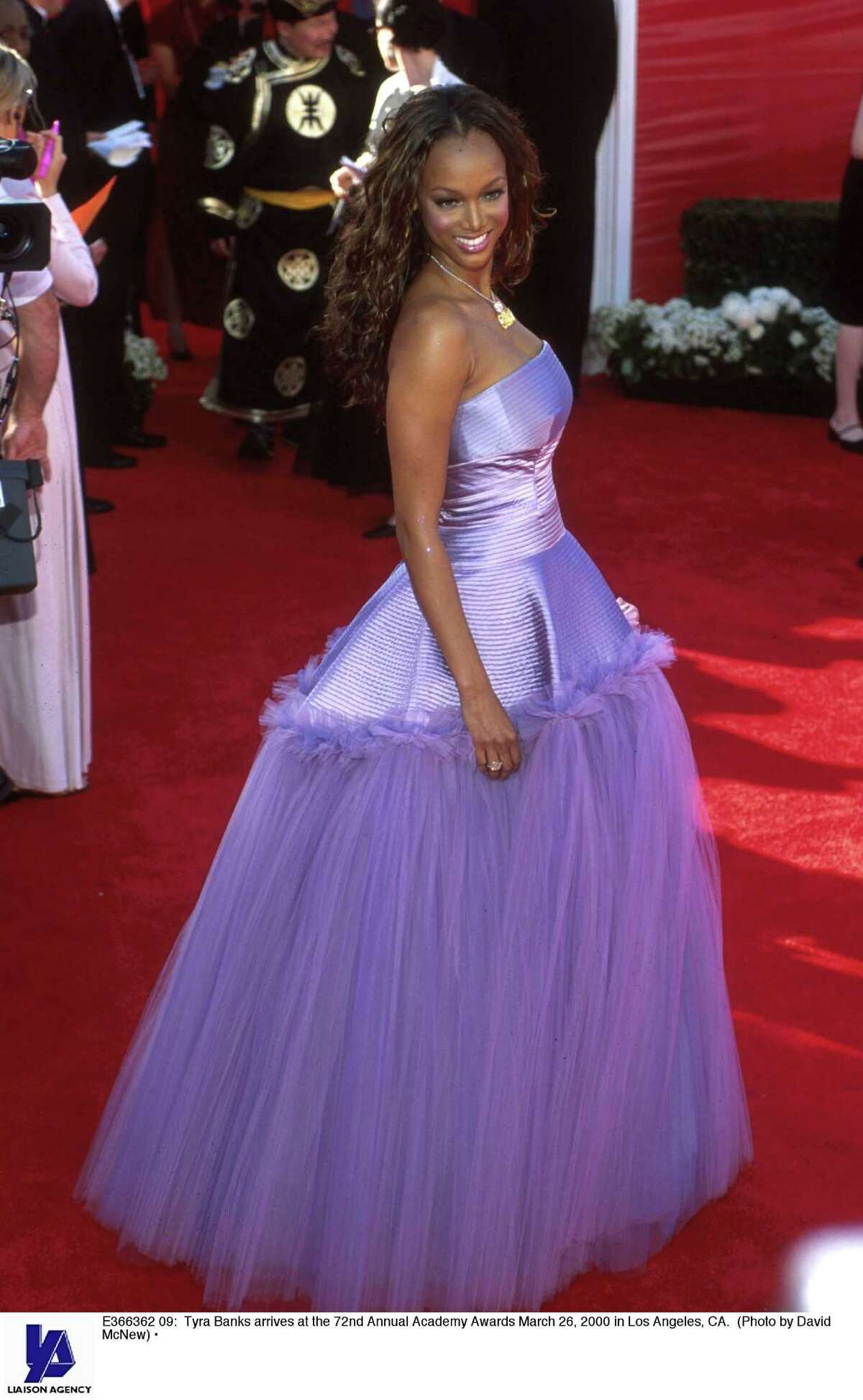 8. Tyra Banks, 2000 Cue the quinceanera music because here comes America's ex-top model in a purple Vera Wang tulle gown that was headed to debut, not the Oscars.