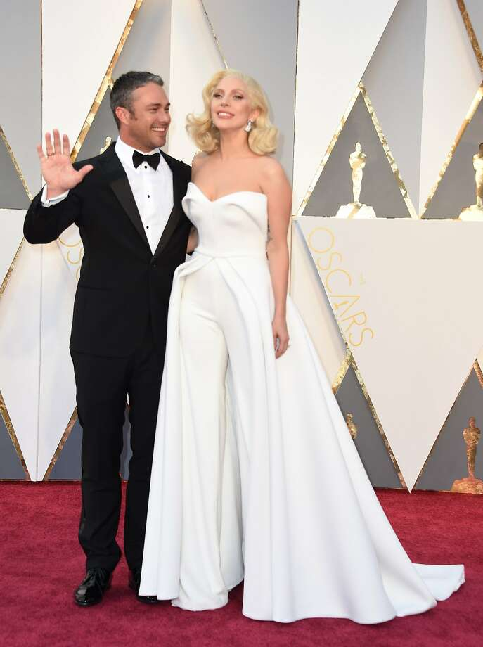 Singer Lady Gaga and Taylor Kinney arrive on the red carpet for the 88th Oscars on February 28, 2016 in Hollywood, California. AFP PHOTO / VALERIE MACONVALERIE MACON/AFP/Getty Images Photo: Valerie Macon, AFP / Getty Images