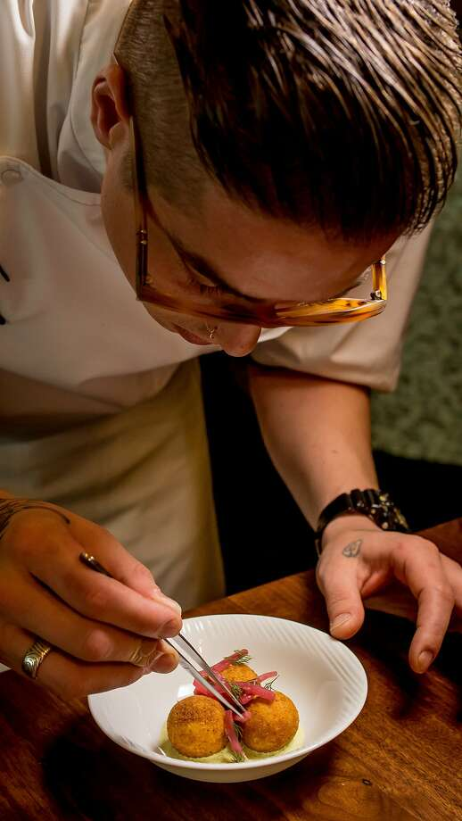 Chef Joey Elenterio  plates the Gravlax Arancini at Cadence. Photo: John Storey, Special To The Chronicle