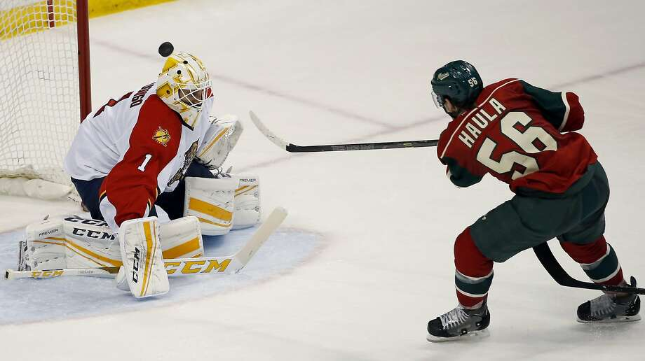 Wild left wing Erik Haula (56) scores on Florida Panthers goalie Roberto Luongo (1) during the third period, helping to end Minnesota's nine-game skid at the Xcel Energy Center. Photo: Ann Heisenfelt, Associated Press