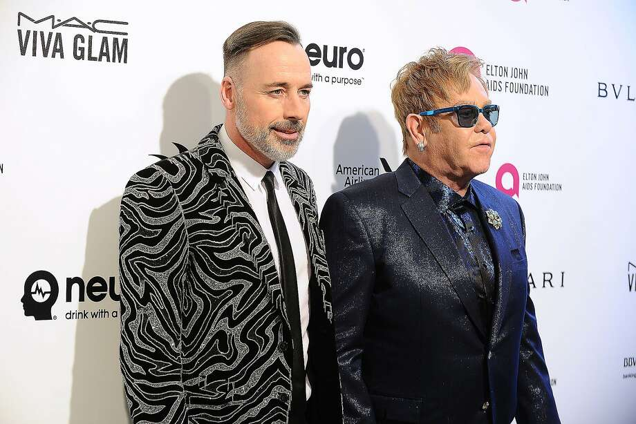 David Furnish and Elton John attend the 24th annual Elton John AIDS Foundation's Oscar viewing party on February 28, 2016 in West Hollywood, California. Photo: Jason LaVeris, Getty Images