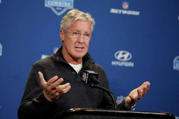 Seattle Seahawks head coach Pete Carroll responds to a question during a news conference at the NFL football scouting combine Thursday, Feb. 25, 2016, in Indianapolis. (AP Photo/Darron Cummings)