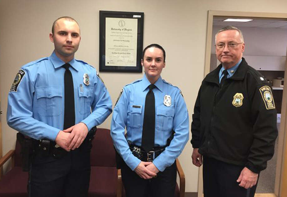 A photo provided by the Prince William County Police Department shows, from the left, Officer Steven Kendall, Officer and Ashley Guindon with Lt. Col. Barry Bernard, deputy chief of the Prince William County, Va., Police Department. Officer Ashley Guindon was shot and killed Saturday, Feb. 28, 2016, and two of her colleagues were wounded in a confrontation stemming from a call about an argument. Guindon and Kendall were sworn in on Friday, and Guindon was working her first shift with the Prince William County Police Department when she was killed. (Prince William County Police Department  via AP) Photo: HOGP / Prince William County Police Dep