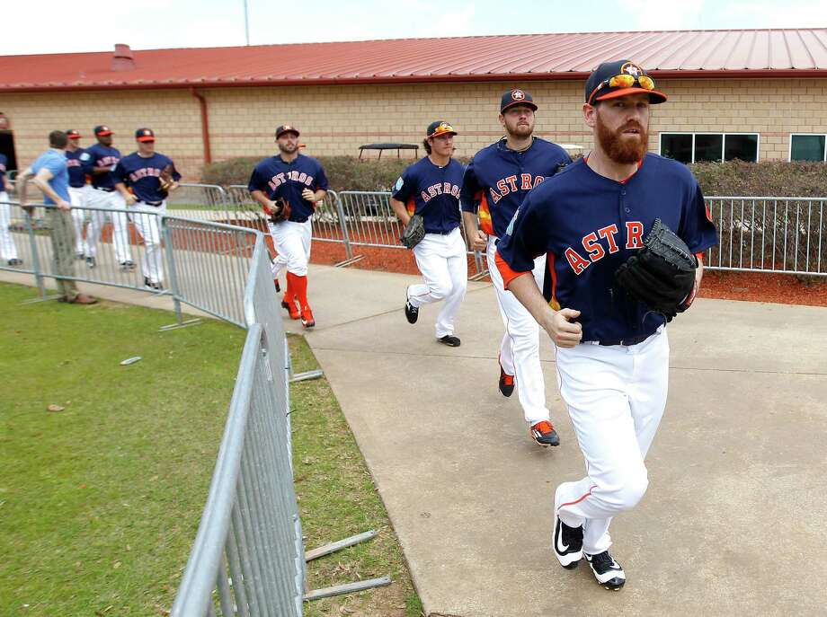 Dan Straily, right, leads the pitchers to the field for a workout, but he may be trailing too many colleagues to land a roster spot. Photo: Karen Warren, Staff / © 2015  Houston Chronicle