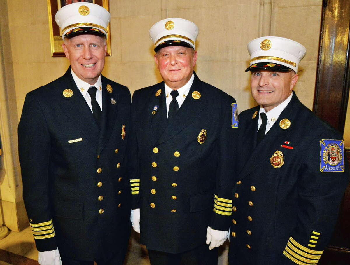 Albany firefighters from left, Executive Deputy Chief of the Department of Fire & Emergency Services Joseph J. Toomey, Deputy Chief Captain Joseph Gregory and Lieutenant Edmund J. Seney during a promotion ceremony Friday Oct. 3, 2014, in Albany, NY. (John Carl D'Annibale / Times Union)