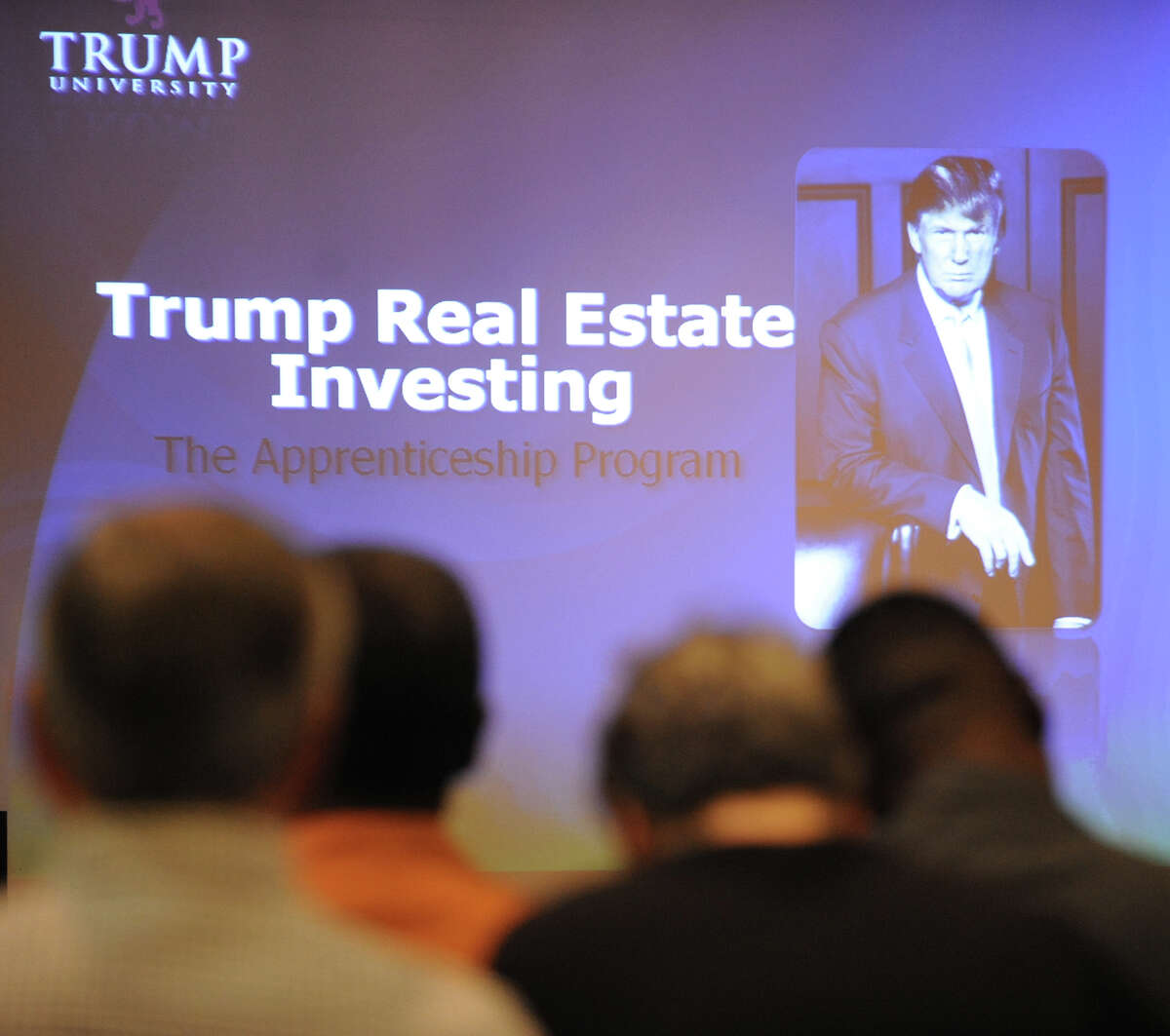 A seminar taught by the professors of Trump University. Donald Trump's photo is shown on the screen at the beginning of the presentation. Illustrates TRUMP-UNIVERSITY, (category a), by Emma Brown (c) 2015 The Washington Post. Moved Sunday, Sept. 13, 2015. (MUST CREDIT: Washington Post photo by Sarah L. Voisin).