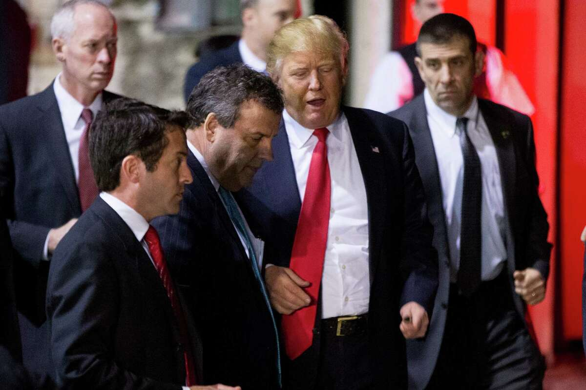 Republican presidential candidate Donald Trump, center right, speaks with New Jersey Gov. Chris Christie, center left, following a rally at Millington Regional Airport in Millington, Tenn., Saturday, Feb. 27, 2016. (AP Photo/Andrew Harnik) ORG XMIT: TNAH143