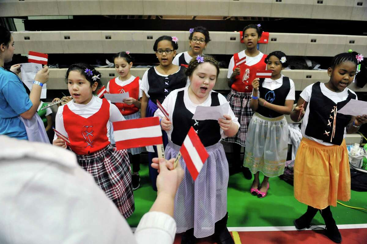 Members of the Girl Scouts Troop 1455 out of Troy sing an Austrian song at the 2016 Girl Scout Southern Region International Fair at Hudson Valley Community College on Sunday, Feb. 28, 2016, in Troy, N.Y. This is the 36th year of the international fair, where area Girl Scout troops display the food and culture of different countries. Girl Scouts is an international organization, and every fall Girl Scout troops begin the process of choosing a country and researching it's culture, customs and crafts. The fair is the culmination of the project with the girls presenting the food and other aspects of the country's culture at a display booth. Kelly Morris, chair person of the international fair committee, said that each year roughly 1,000 visitors come through the doors to see the displays and taste the food. Forty-six countries were represented at the fair, with 31 troops taking part Morris said. (Paul Buckowski / Times Union)