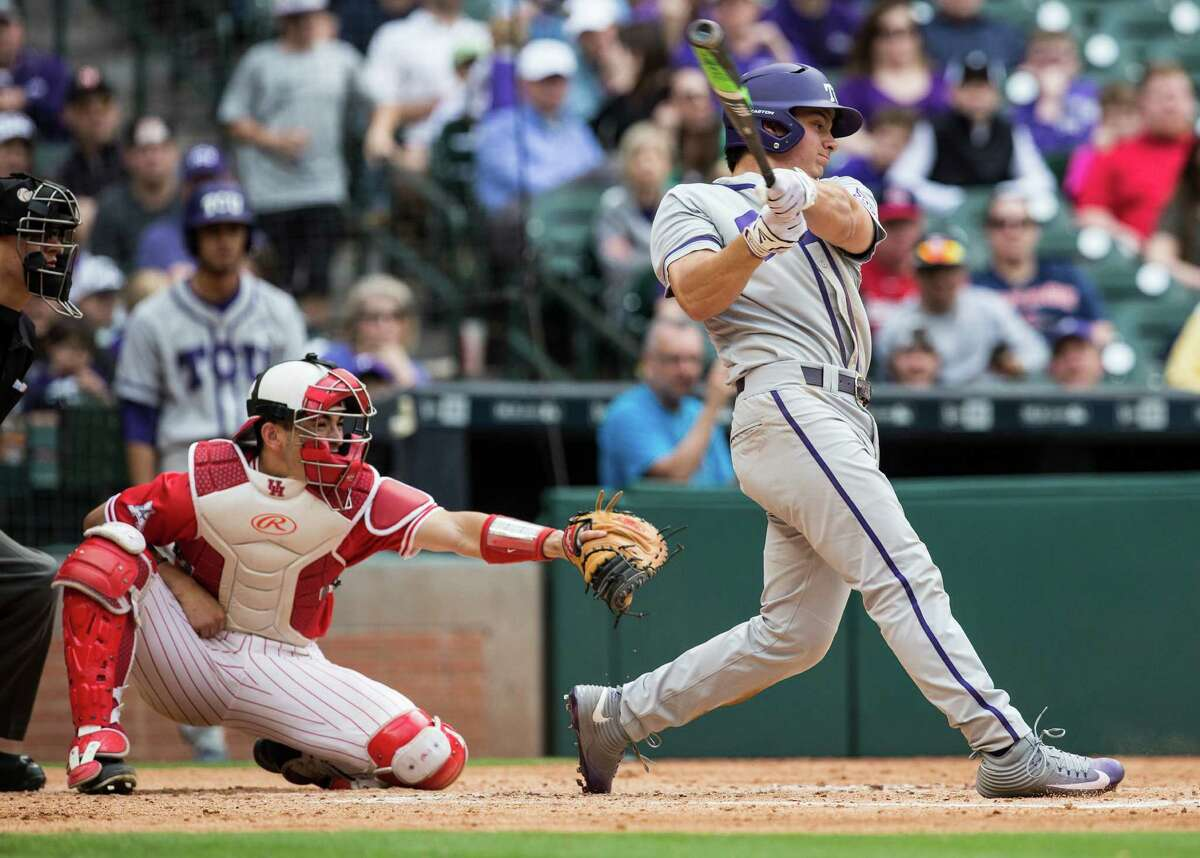 TCU outfielder Josh Watson (7) hits a three-run home run off Houston starter Mitch Ullom during the third inning of a Houston College Classic baseball game at Minute Maid Park on Sunday, Feb. 28, 2016, in Houston.