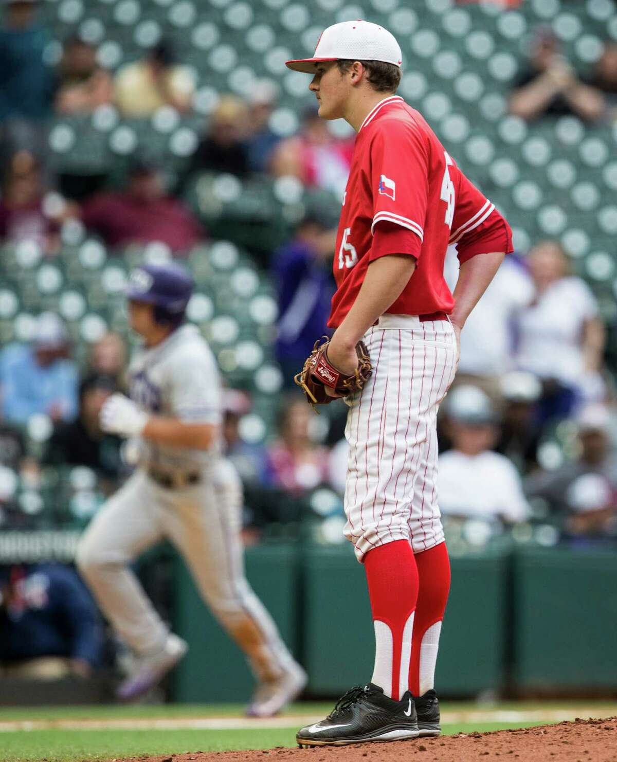 Houston pitcher Mitch Ullom (45) stands on the mound as TCU outfielder Josh Watson (7) rounds the bases after hitting a three-run home run during the third inning of a Houston College Classic baseball game at Minute Maid Park on Sunday, Feb. 28, 2016, in Houston.