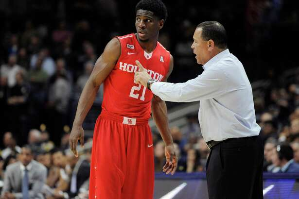 UH coach Kelvin Sampson, right, gives guidance to Damyean Dotson, who in turn led the Cougars with 22 points and 14 rebounds Sunday from his guard position.