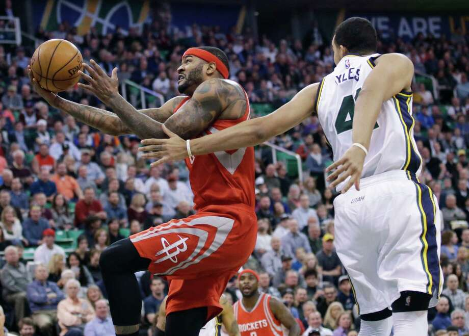 Although he is mired in an eight-game shooting slump, the Rockets' Josh Smith, left, has connected on 45.3 percent of his shots during his 12-year career. Photo: Rick Bowmer, STF / AP