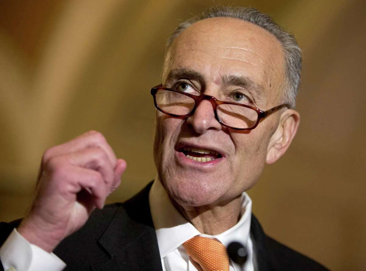 FILE - In this Oct. 20, 2015, file photo, Sen. Charles Schumer, D-N.Y. talks to media on Capitol Hill in Washington. Schumer wants to require the Federal Aviation Administration to establish seat-size standards for commercial airlines, which he says now force passengers to sit on planes