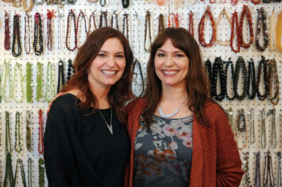 Twins Theresa, left, and Christina Albanese, who were born on leap day, 1968, stand in River Rocks, a bead store they own on River Street on Tuesday, Feb. 23, 2016 in Troy, N.Y. (Lori Van Buren / Times Union)