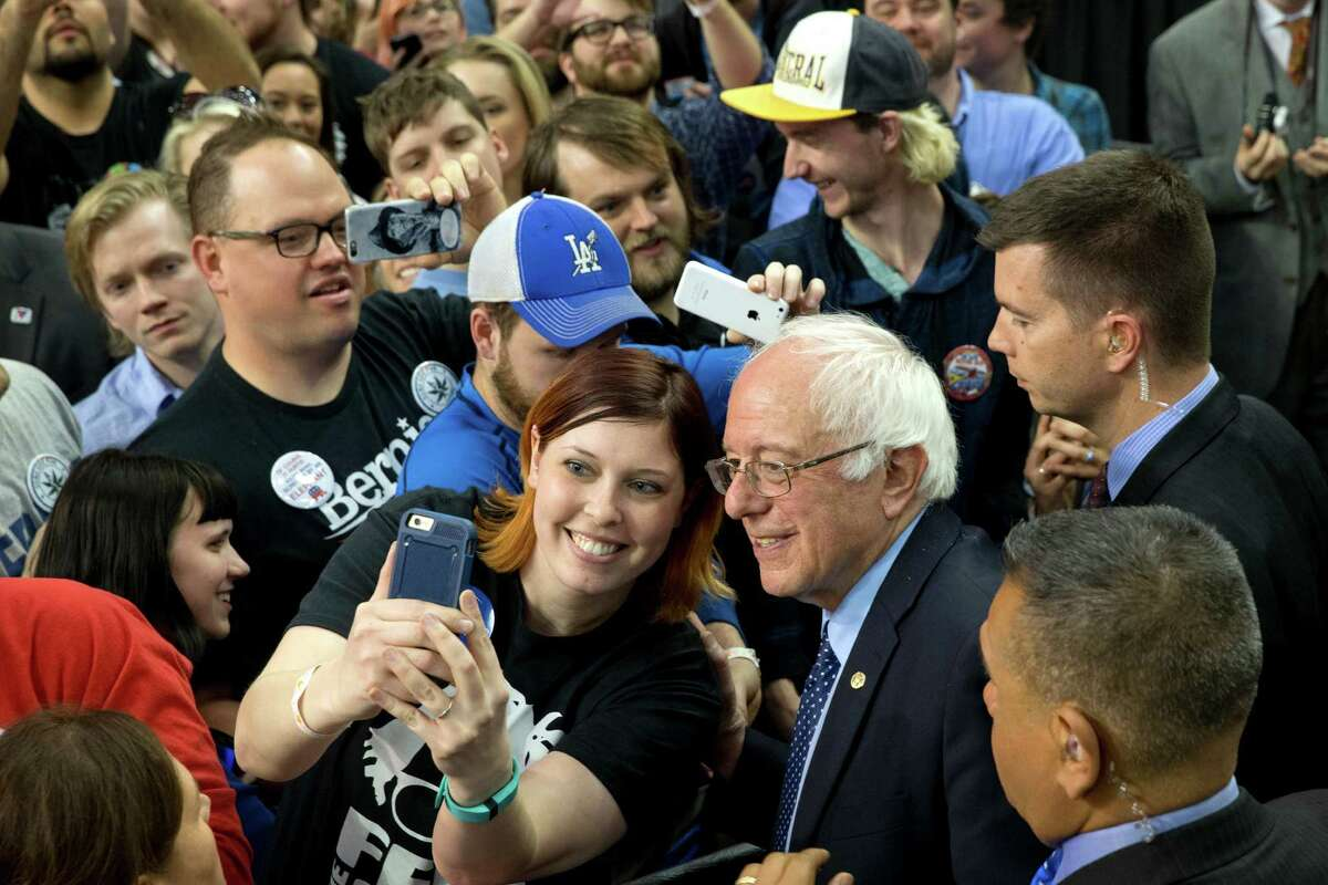 Democratic presidential candidate Sen. Bernie Sanders, I-Vt., takes selfies with the crowd during a campaign rally at the Cox Convention Center Arena in Oklahoma City, Okla., Sunday, Feb. 28, 2016. (AP Photo/Jacquelyn Martin) ORG XMIT: OKJM114