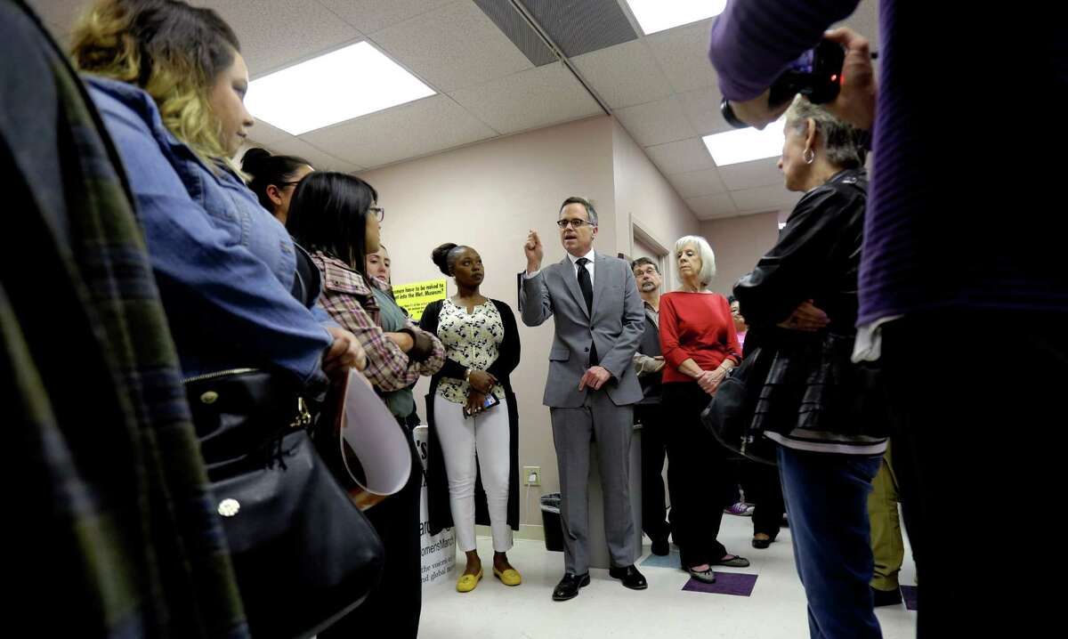 Planned Parenthood South Texas CEO Jeffrey Hons, center, speaks during a gathering at Whole Woman's Health of San Antonio, Tuesday, Feb. 9, 2016, in San Antonio. The Supreme Court will soon hear Whole Woman's Health's challenge to HB2, Texas legislation that requires all abortion facilities to meet heightened requirements by becoming ambulatory service centers. (AP Photo/Eric Gay)