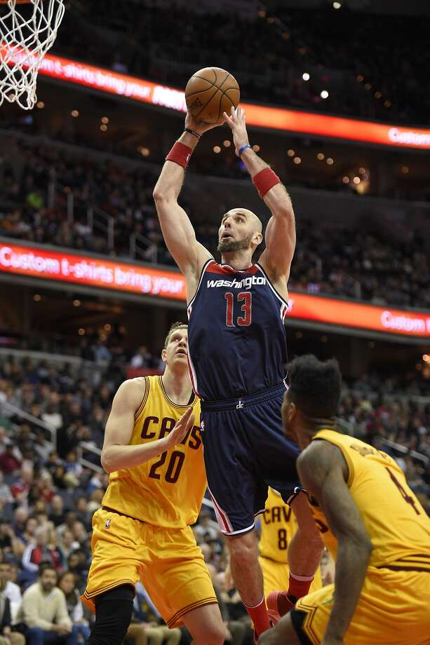 Washington center Marcin Gortat goes to the basket between Cavaliers center Timofey Mozgov (20) and guard Iman Shumpert during the second half of the Wizards' win in Washington, D.C. Photo: Nick Wass, Associated Press