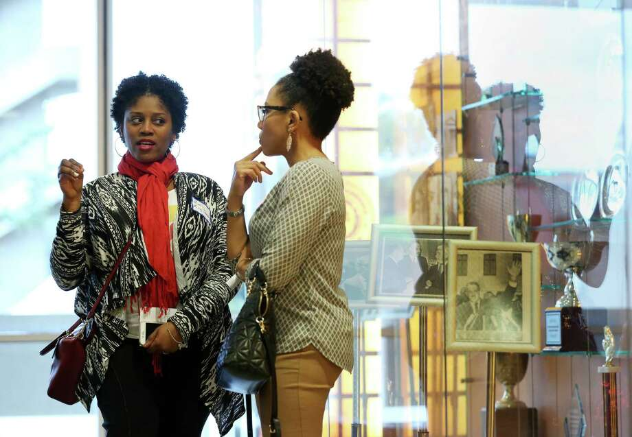 Kelli King-Jackson, left, speaks with Anitra Green on Sunday during the Texas launch of Women of Color for Hillary at TSU's Thurgood Marshall School of Law. Photo: Jon Shapley, Staff / © 2015  Houston Chronicle