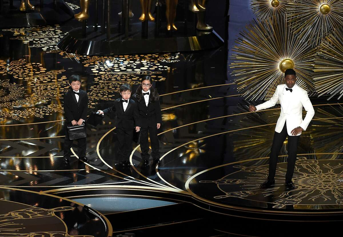Host Chris Rock, right, and children participate in a skit at the Oscars on Sunday, Feb. 28, 2016, at the Dolby Theatre in Los Angeles.