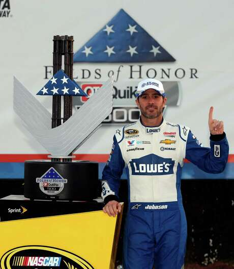 HAMPTON, GA - FEBRUARY 28:  Jimmie Johnson, driver of the #48 Lowe's Chevrolet, poses in Victory Lane after winning the NASCAR Sprint Cup Series Folds of Honor QuikTrip 500 at Atlanta Motor Speedway on February 28, 2016 in Hampton, Georgia.  (Photo by Brian Lawdermilk/Getty Images) Photo: Brian Lawdermilk, Stringer / 2016 Getty Images
