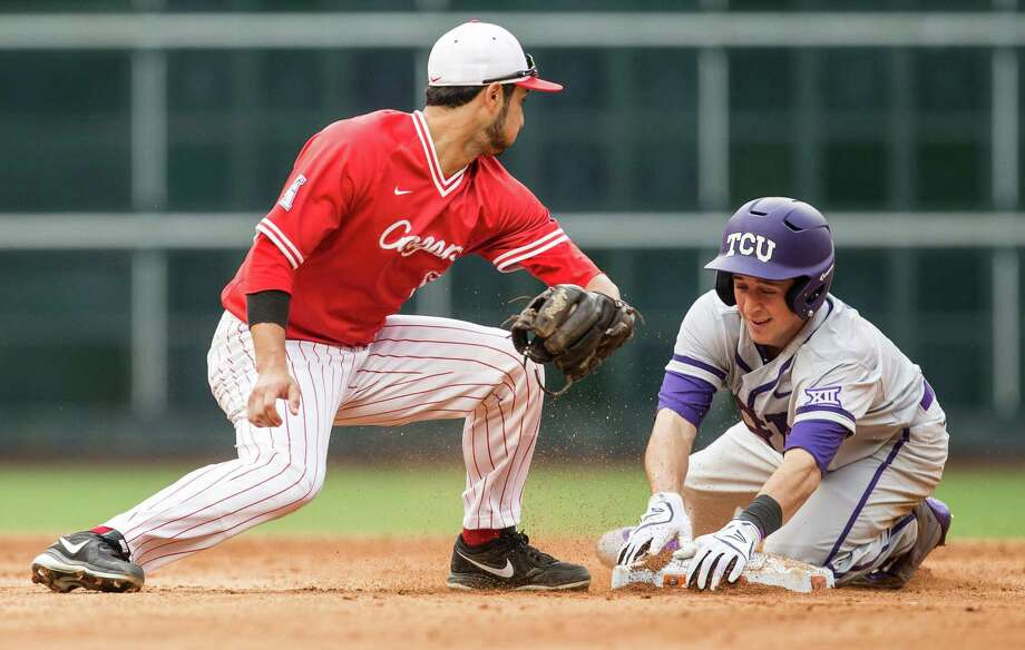 TCU's Mason Hesse easily beats the tag of UH's Jose Reyes, left, for a double to ignite the Horned Frogs' five-run third inning Sunday at Minute Maid Park. Photo: Brett Coomer, Staff / © 2016 Houston Chronicle