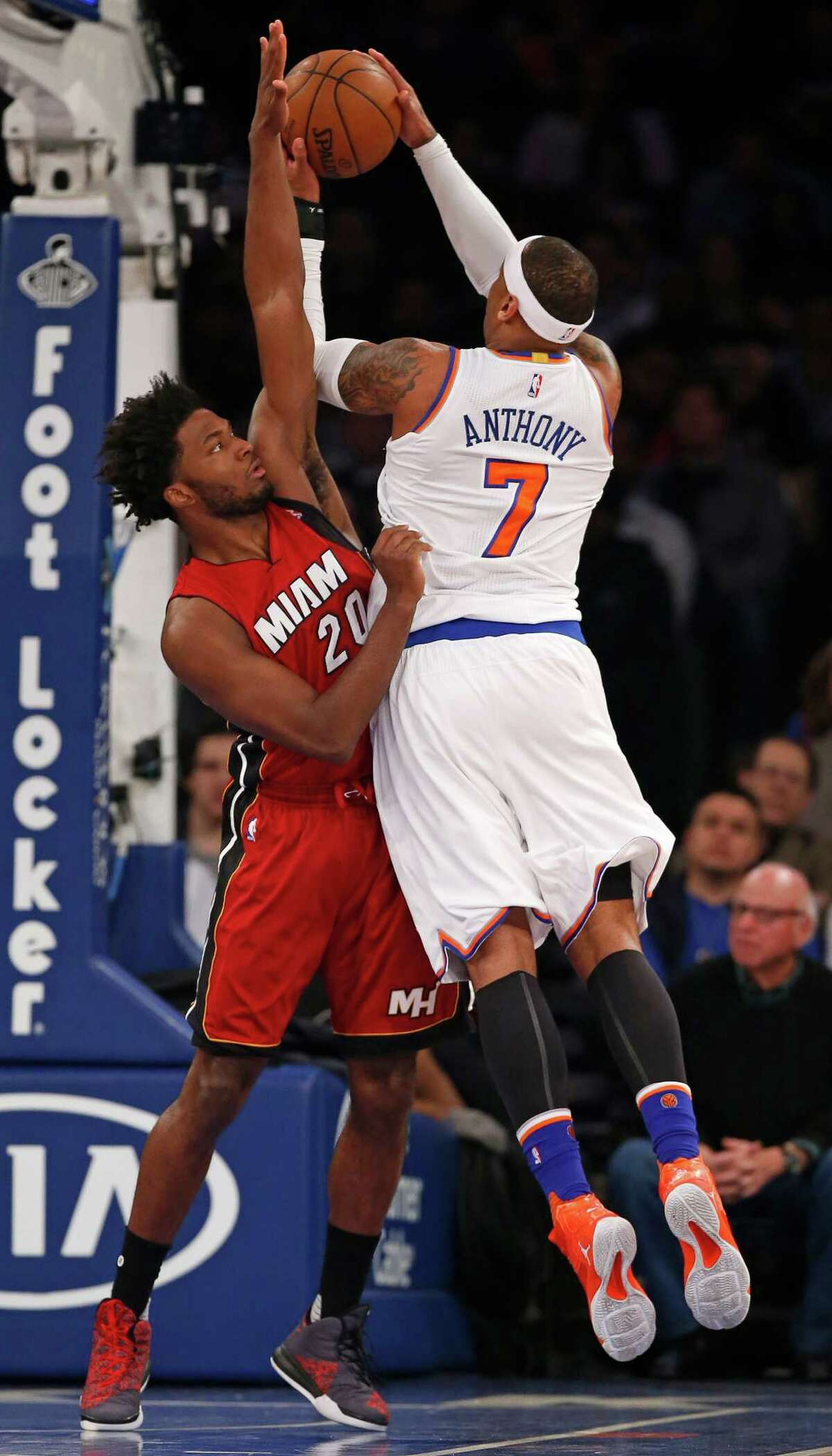 Miami Heat forward Justise Winslow (20) defends New York Knicks forward Carmelo Anthony (7) in the first half of an NBA basketball game at Madison Square Garden in New York, Sunday, Feb. 28, 2016. (AP Photo/Kathy Willens) ORG XMIT: MSG106