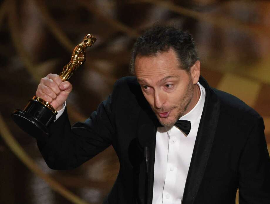 Cinematographer Emmanuel Lubezki accepts his award for Best Cinematography, The Revenant  stage at the 88th Oscars. Photo: MARK RALSTON, Staff / AFP