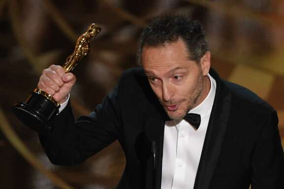 Cinematographer Emmanuel Lubezki accepts his award for Best Cinematography, The Revenant  stage at the 88th Oscars.
