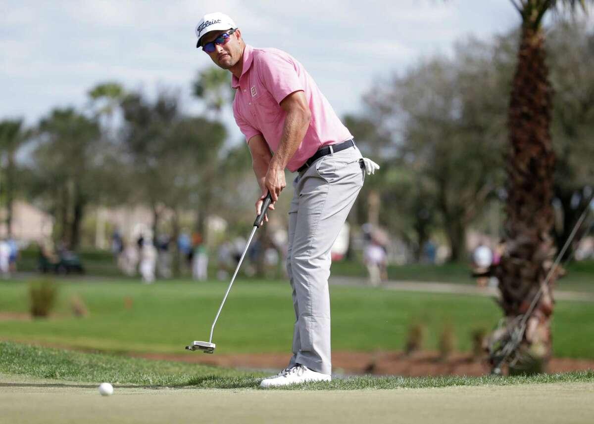 Adam Scott, of Australia, watches his putt on the third green during the fourth round of the Honda Classic golf tournament, Sunday, Feb. 28, 2016, in Palm Beach Gardens, Fla. (AP Photo/Lynne Sladky) ORG XMIT: FLLS102