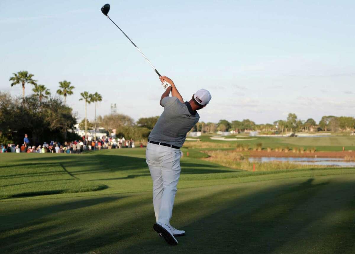 Adam Scott, of Australia, tees off on the 18th hole during the third round of the Honda Classic golf tournament, Saturday, Feb. 27, 2016, in Palm Beach Gardens, Fla. (AP Photo/Lynne Sladky) ORG XMIT: FLLS116