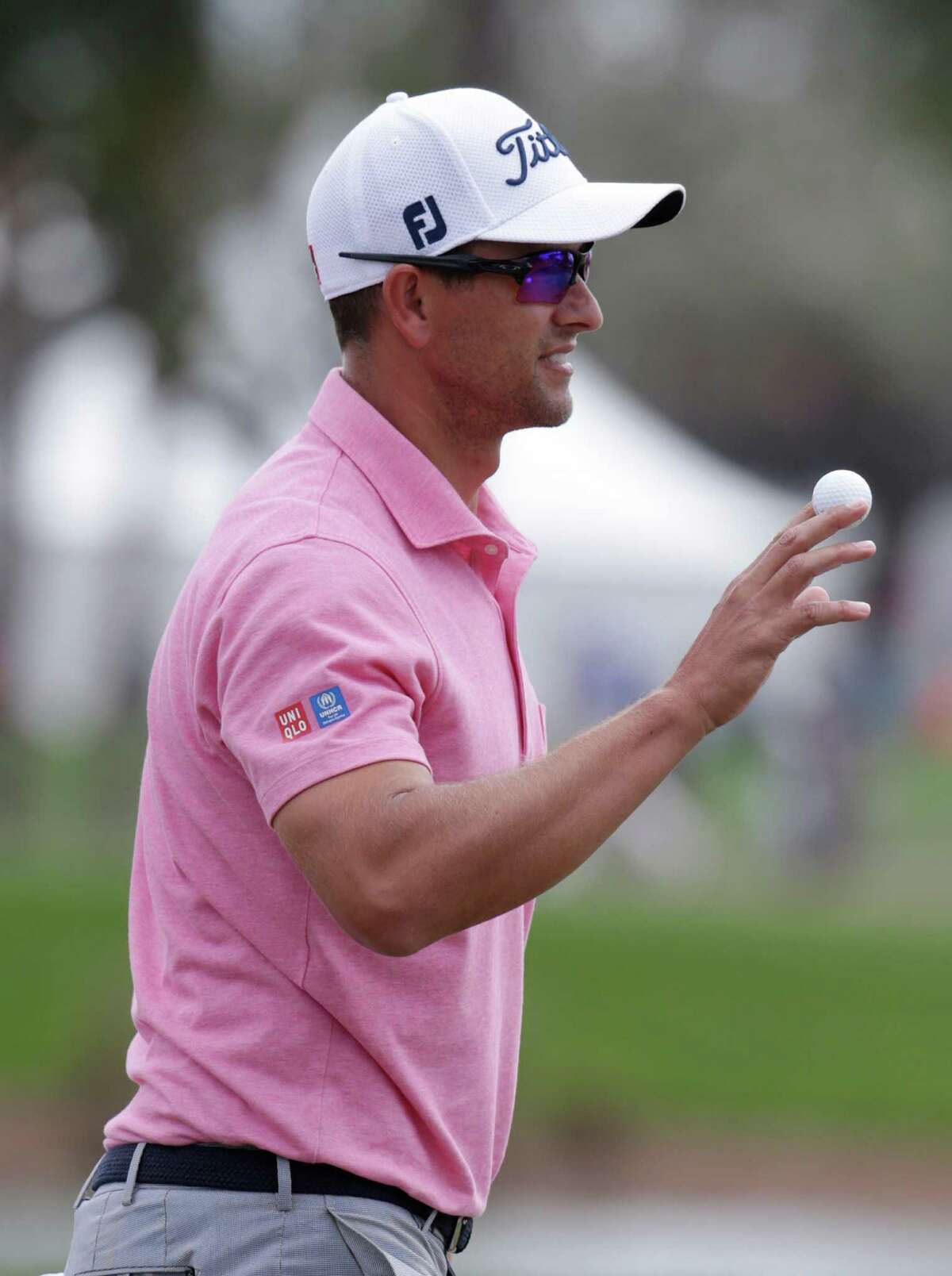Adam Scott, of Australia, holds up the ball after a birdie putt on the first hole during the fourth round of the Honda Classic golf tournament, Sunday, Feb. 28, 2016, in Palm Beach Gardens, Fla. (AP Photo/Lynne Sladky) ORG XMIT: FLLS107